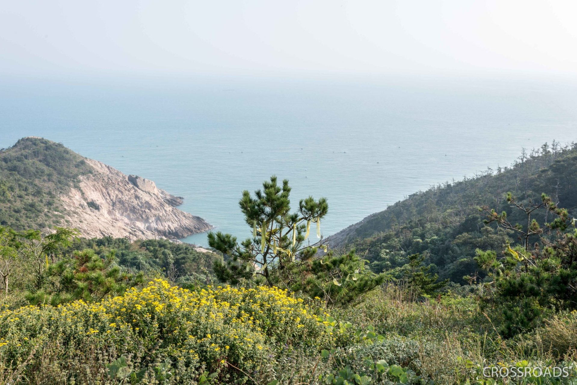 The sinking point of the Sewol Ferry is seen from the hill top at a distance of 1.6 km. The parents of the Sewol victims set up several tents – all carried up the hill on their backs – in this spot in September 2015, with some always present and watching the sea until the ferry was raised in March 2017.
